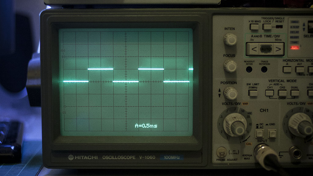 Oscilloscope displaying one millisecond square wave